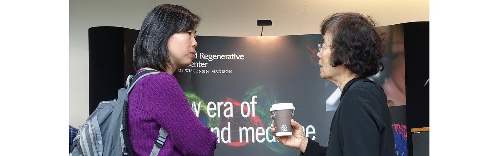 Xinyu Zhao and Ei Terasawa at Wisconsin Stem Cell Symposium
