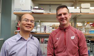 Wan-Ju Li and Brian Walczak in the lab.